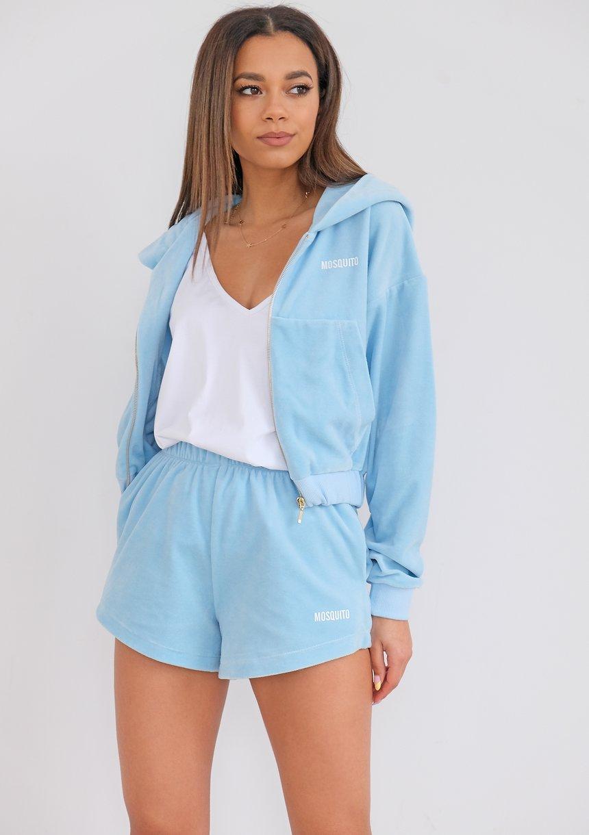 Women Light blue velvet sweatshirt with a zipper closure