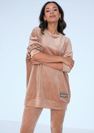 Long women's beige velvet sweatshirt